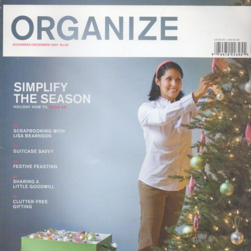 """Cover of """"Organize"""" magazine of woman decorating a christmas tree"""