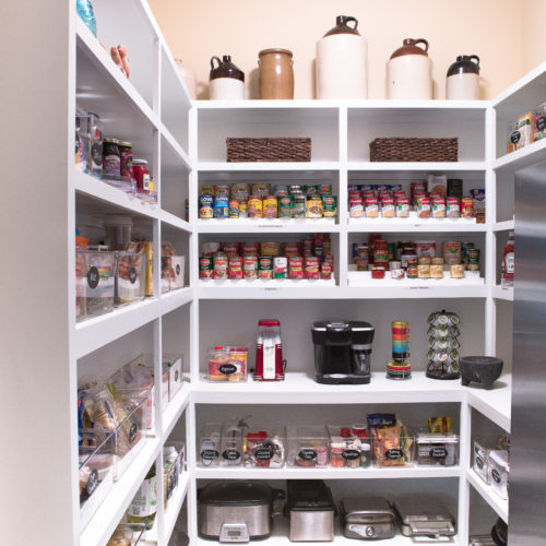 organized pantry stocked with canned goods and more