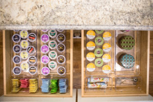 organized drawer with drawer dividers storing coffee pods and tea