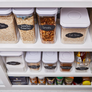 Organized pantry with lined up bins
